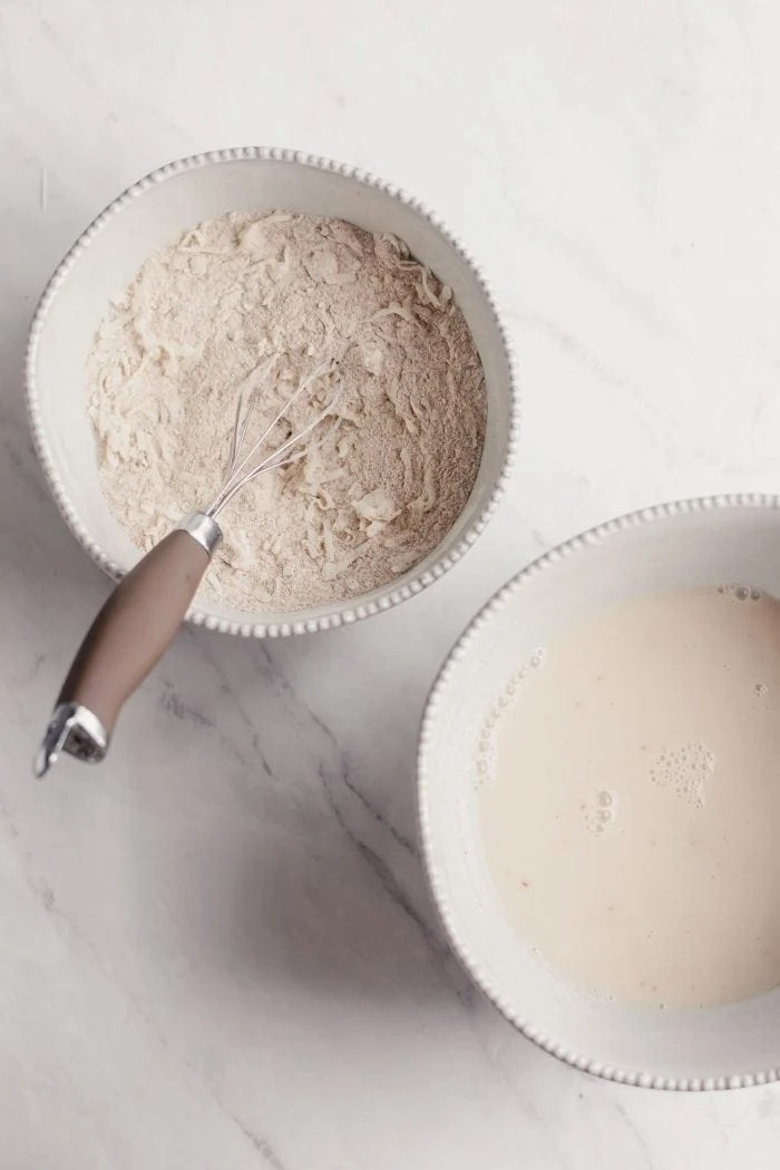One bowl with flour and coconut, one bowl with almond milk.
