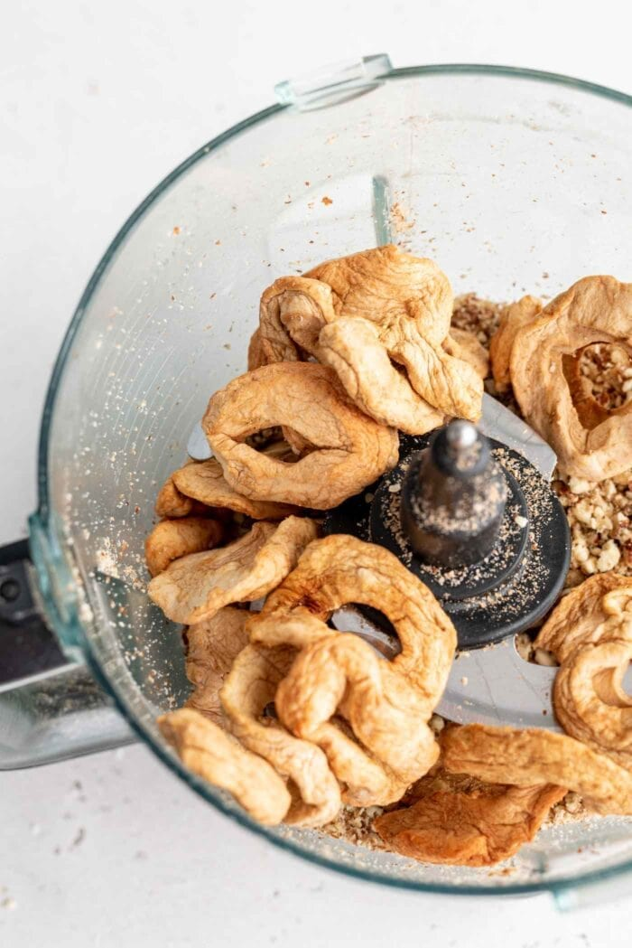 Dried apple rounds in a food processor.