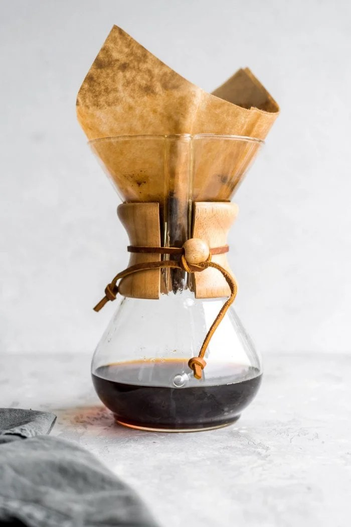 Chemex coffee maker with brewed coffee in it.