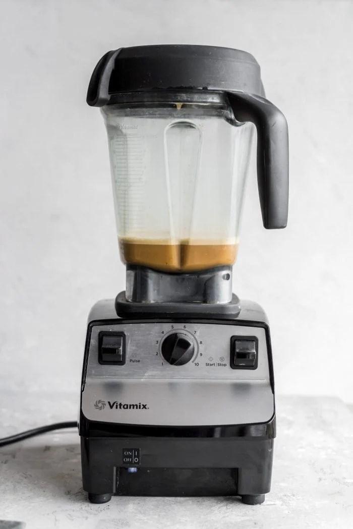 Blended vegan bulletproof coffee in a Vitamix blender.
