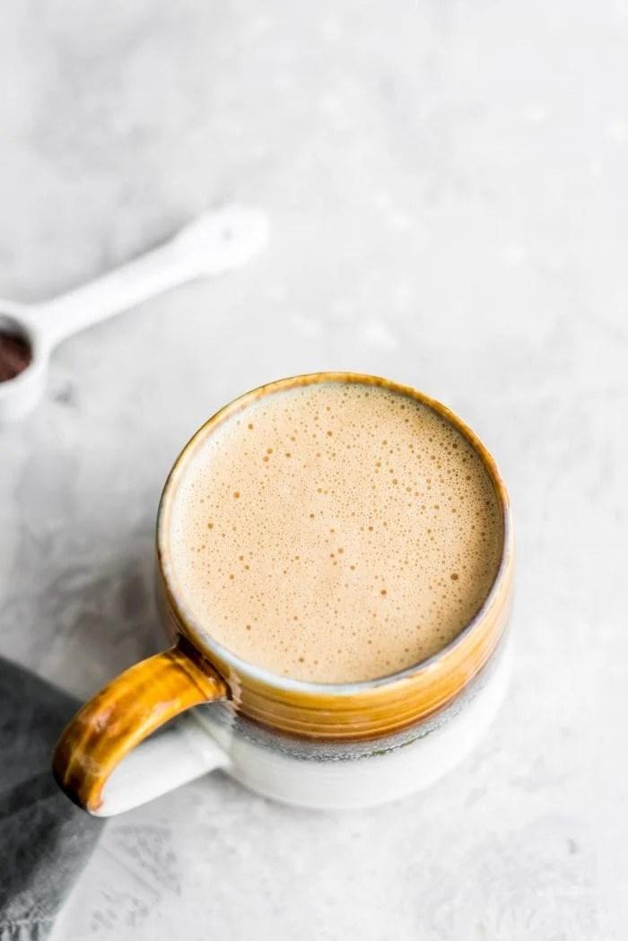 Vegan bulletproof coffee in a mug.