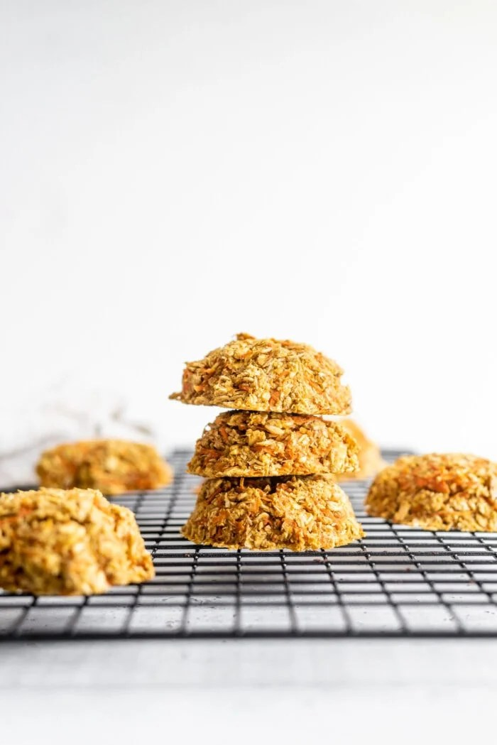 Stack of healthy vegan carrot cookies sitting on a cooling rack.