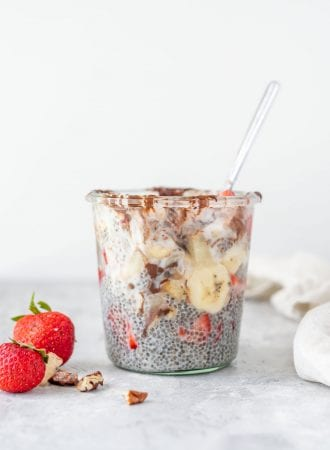 Chia seed pudding with banana and strawberries in a glass jar.