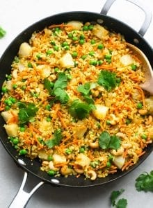 Vegan cashew cauliflower rice with pineapple, peas and cilantro.