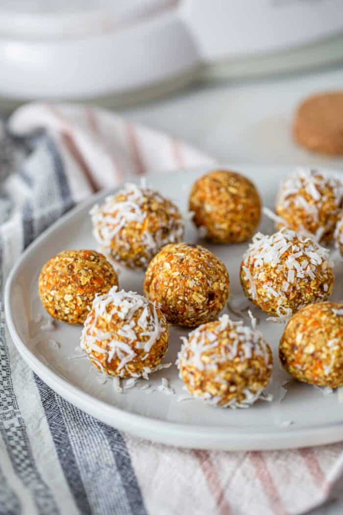 A plate of carrot energy balls rolled in coconut.