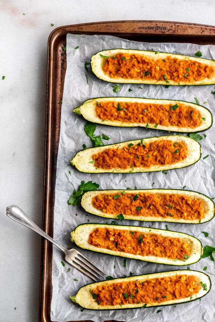 Cooked vegan chickpea stuffed zucchini boats.