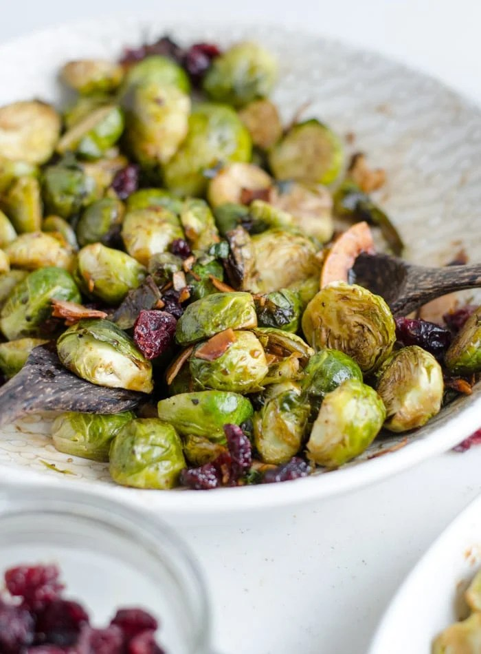 Balsamic Brussel Sprouts Roasted in a Maple Glaze and topped with cranberries and walnuts.