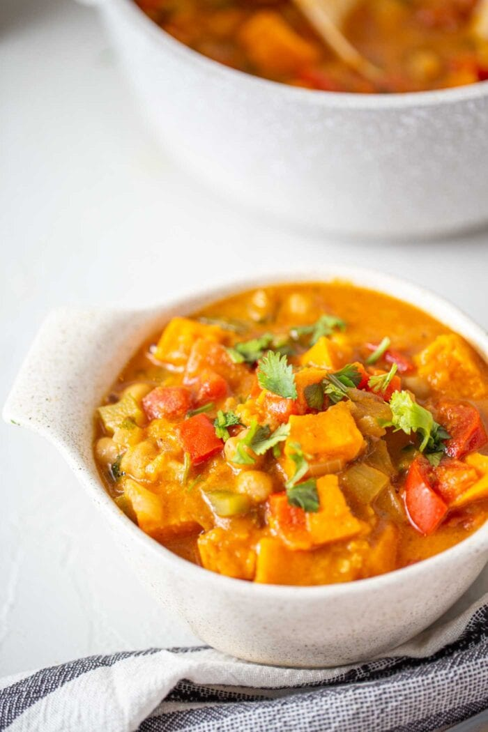A bowl of sweet potato stew topped with cilantro.