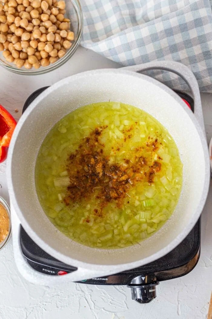 Sauteed celery, onion and spices in a large soup pot.