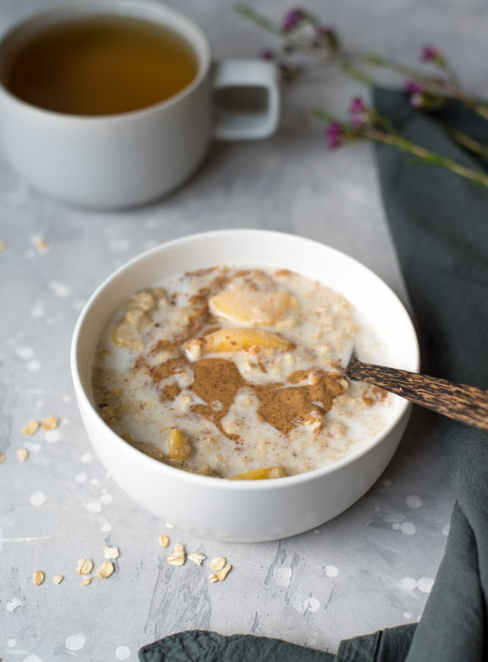 Vegan Peaches and Cream Oatmeal with Almond Butter and Flax Seeds