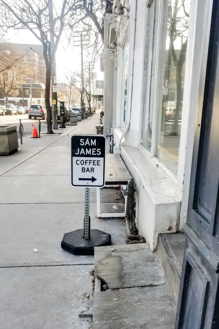 Sam James Coffee Bar sign in Toronto on Queen Street West.