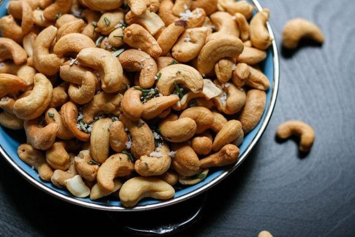 Close up of cashews with sea salt.