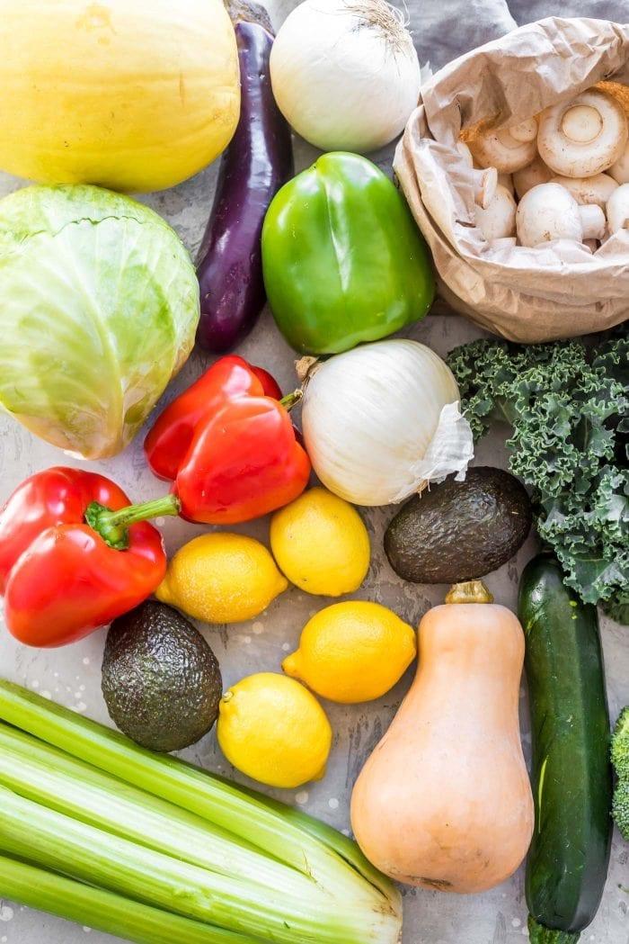 Cabbage, lemons, butternut squash, mushrooms, avocado and more ready for vegan meal prep.