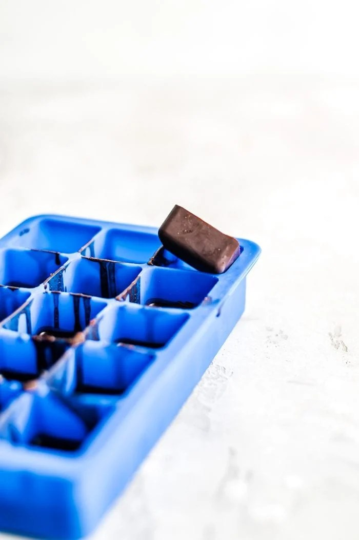 A coconut oil chocolate fat bomb on a silicone ice cube tray.