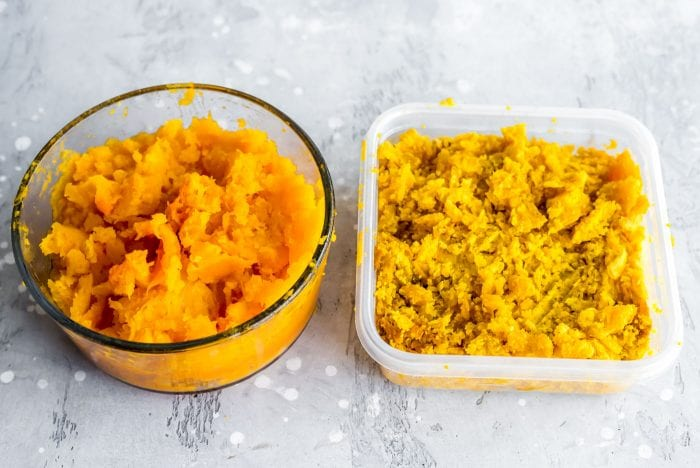Mashed butternut squash and kabocha squash in food storage containers.
