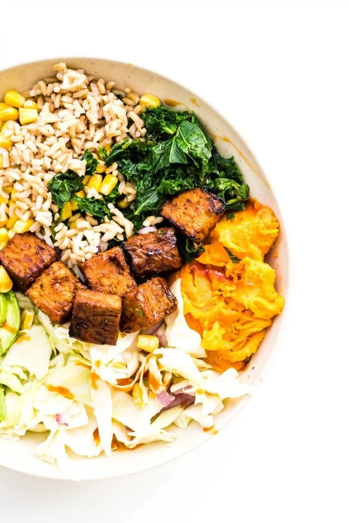 BBQ Tempeh in a bowl with sweet potato, kale and corn.