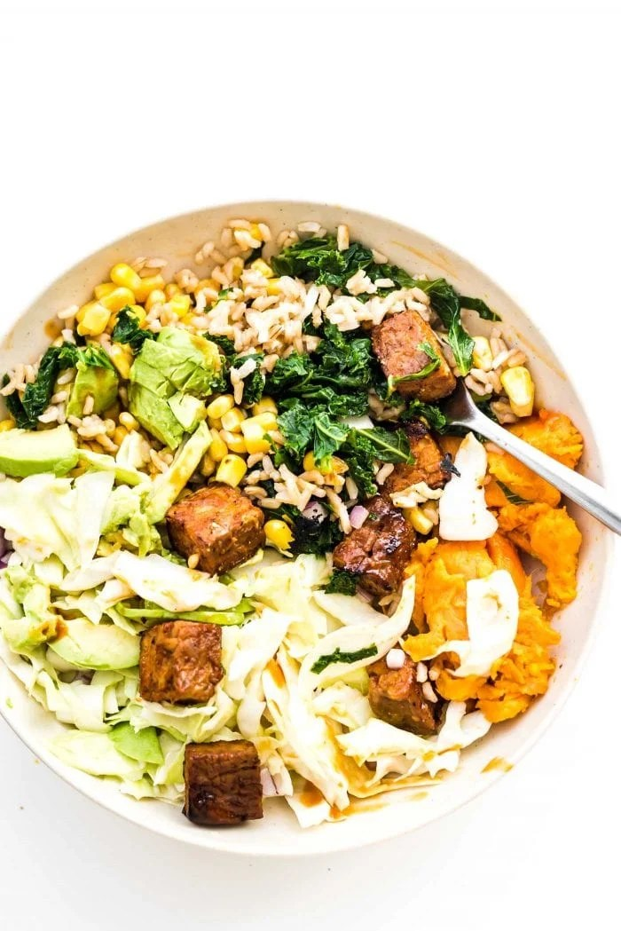 BBQ tempeh, kale, brown rice, sweet potato and corn in a BBQ Tempeh bowl.