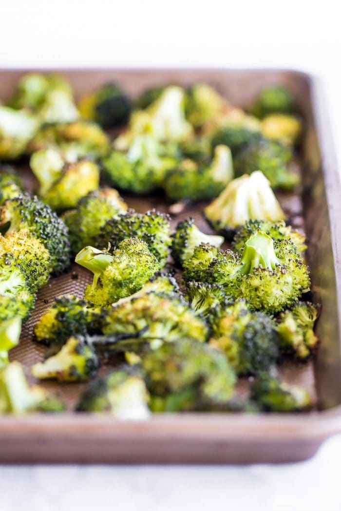 Pan of roasted broccoli cooked with extra virgin olive oil.