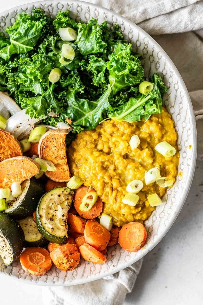 Curried red lentils with kale and roasted vegetables.