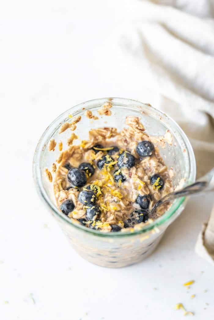 Overnight oats with blueberries in a jar.