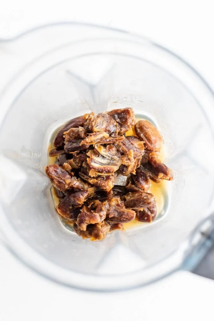 Pitted dates and water in a Vitamix container.