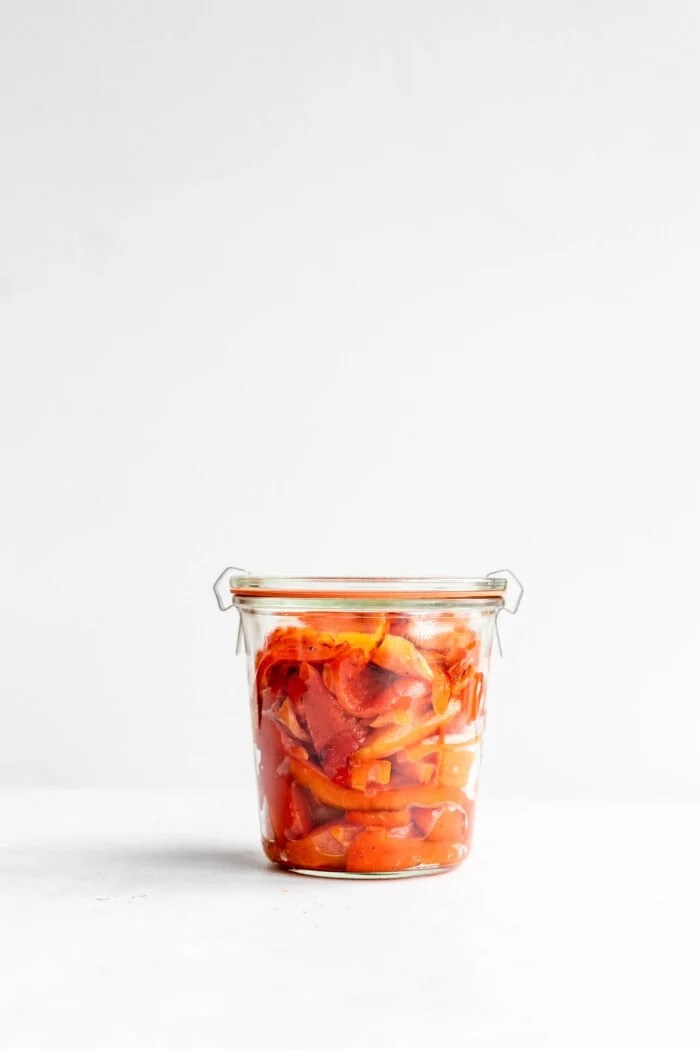 Sealed Weck jar packed with roasted red peppers.
