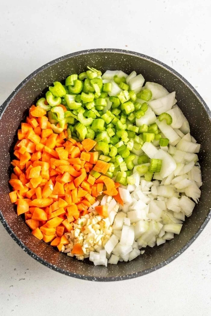 Diced carrot, onion, celery and garlic in a skillet.
