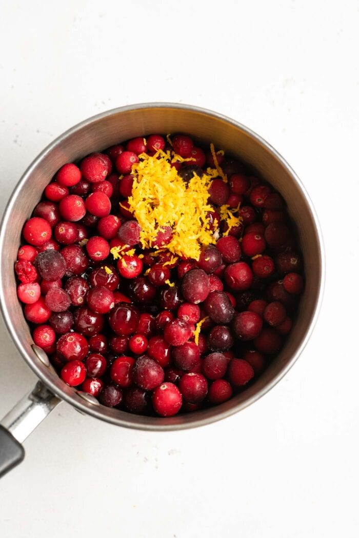 Whole cranberries, maple syrup and orange zest in a medium-sized saucepan.