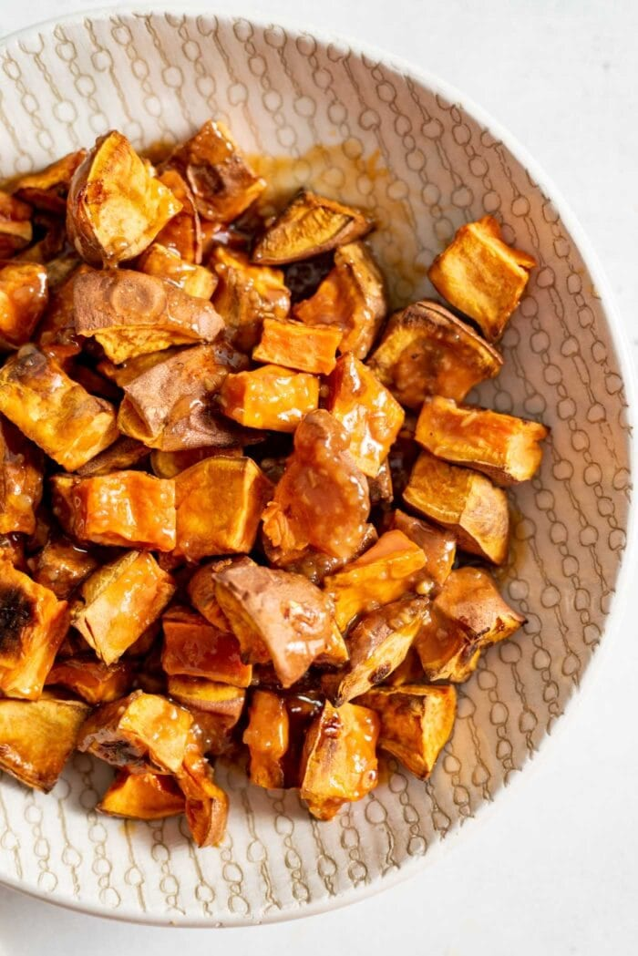 A bowl of miso glazed sweet potato.