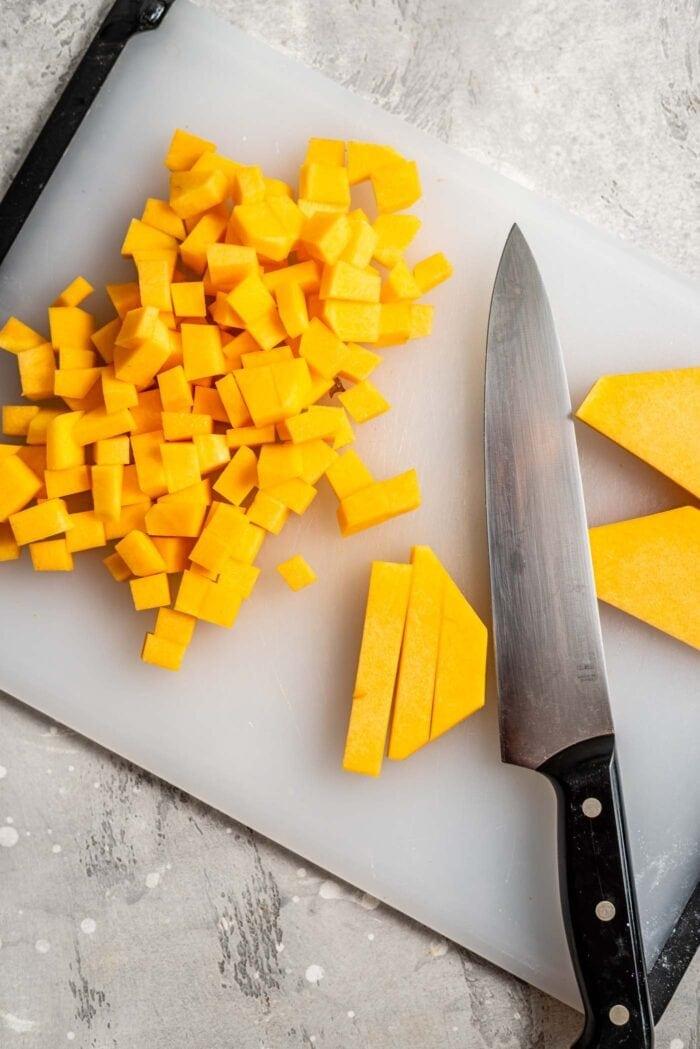 Chopped butternut squash on a cutting board.