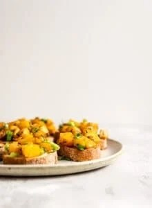 A plate of butternut squash bruschetta.