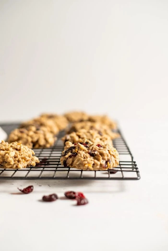 Cranberry chocolate chip cookies cooling on a cooling rack.