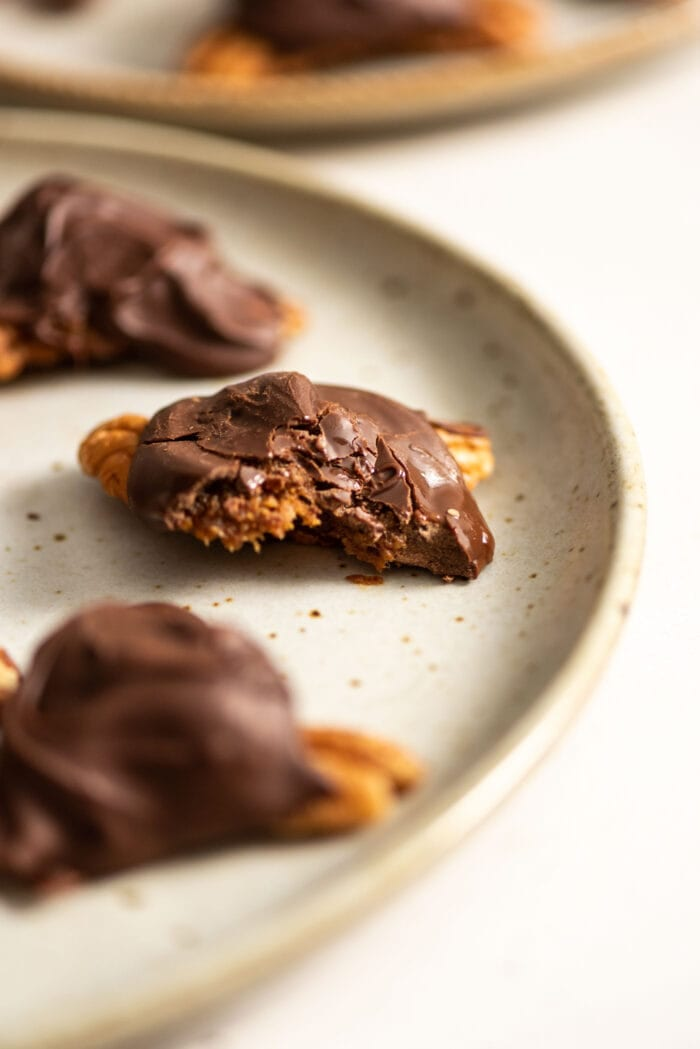 Homemade chocolate vegan turtles on a plate.