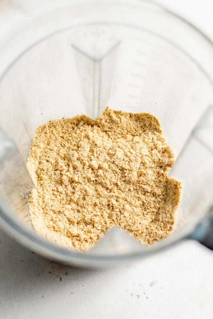 Blended vegan parmesan cheese in a blender.