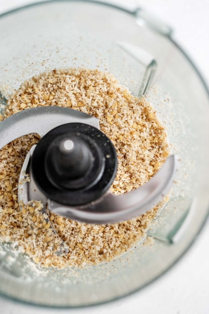 Blended coconut and walnuts in a food processor.