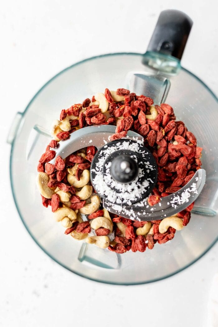 Goji berries, cashews and coconut in a food processor.