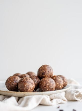 A plate full of chocolate energy balls.