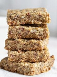 Stack of baked tahini bars on a mobile surface.