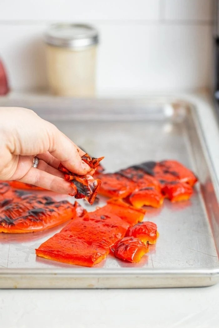 Peeling the skin off roasted red peppers.