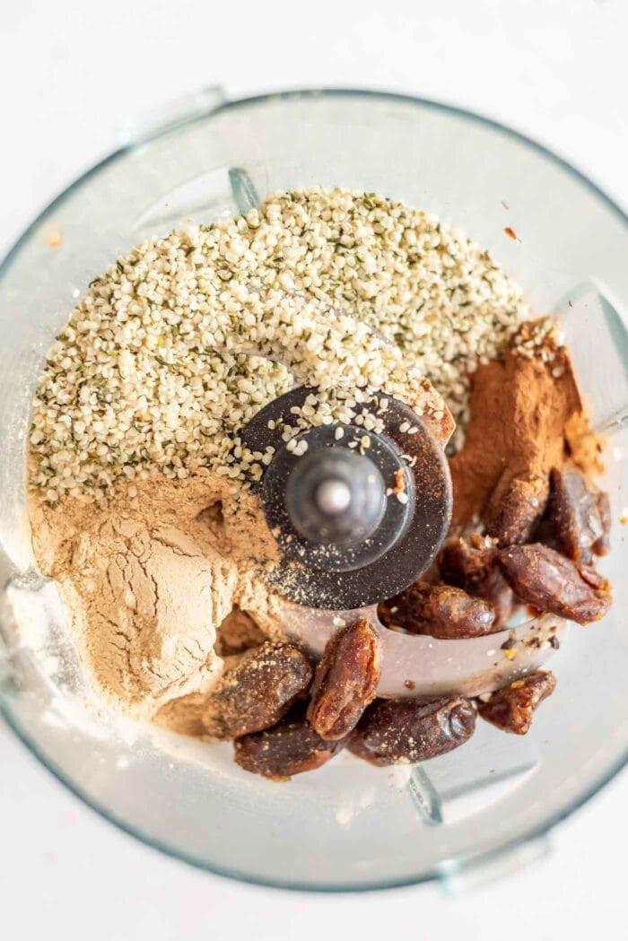 Dates, hemp seeds, maca and cinnamon in a food processor.