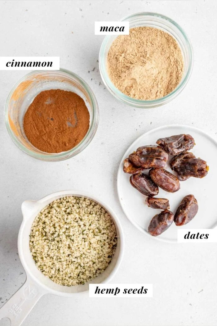 Hemp seeds, dates, cinnamon and maca in containers.