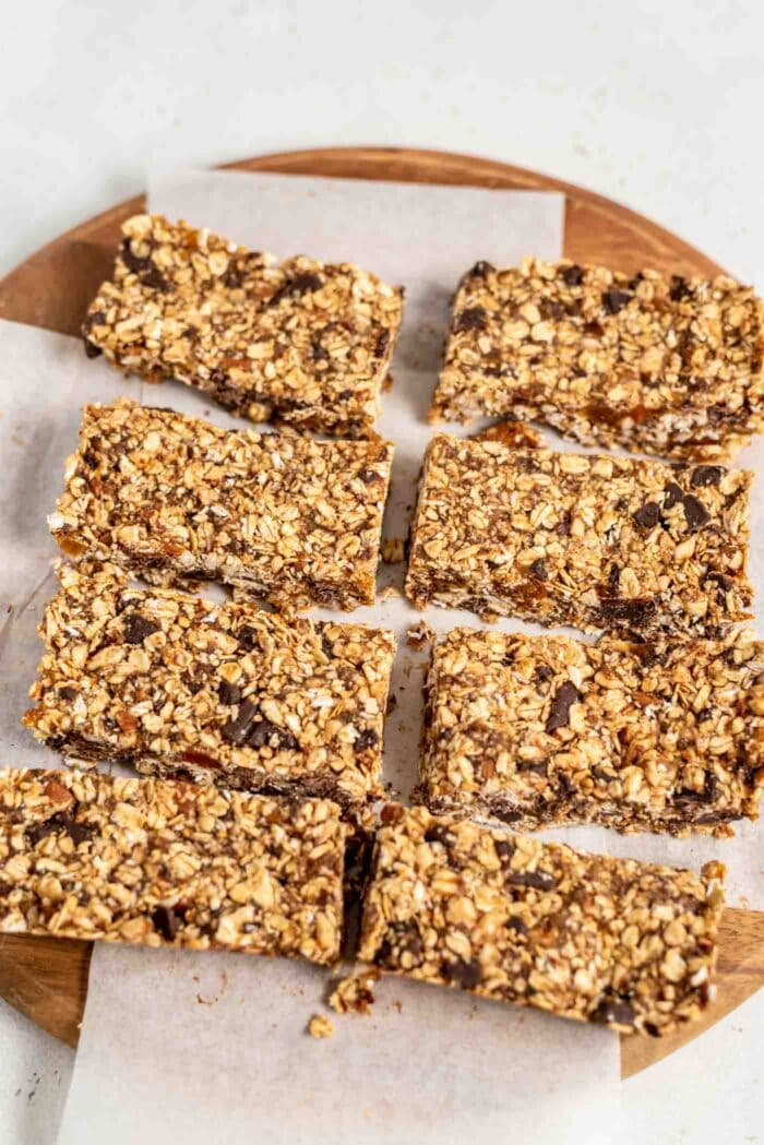 8 large granola bars on a cutting board.