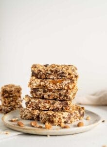 A stack of homemade granola bars on a plate.