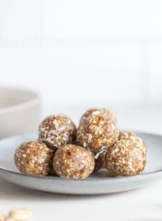 A pile of raw energy balls on a small plate.