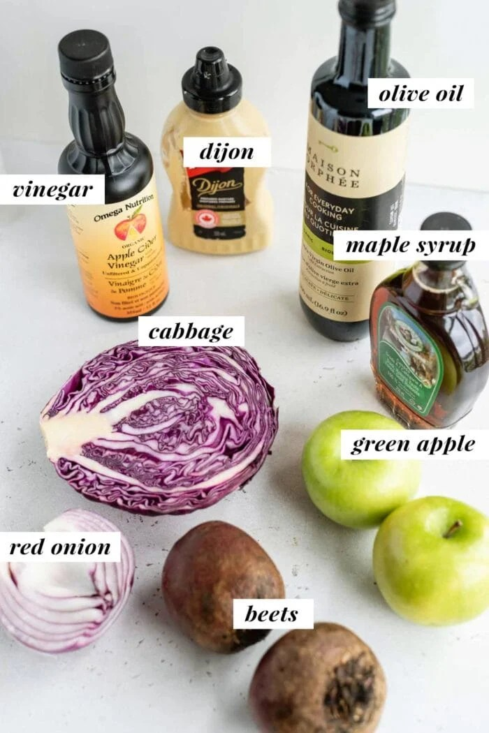 Labelled ingredients for a beet, apple and cabbage salad.