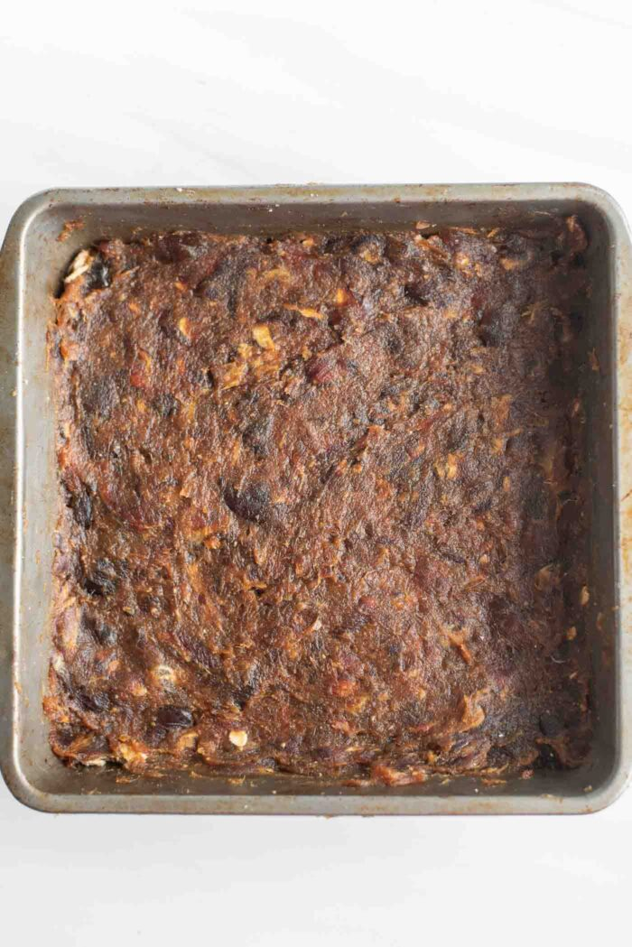 Date paste spread in a baking pan.