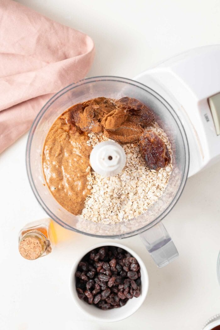Oats, almond butter and dates in a food processor.