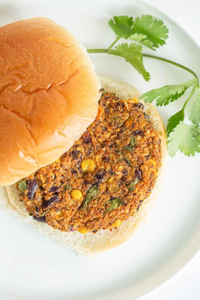 A sweet potato burger pattie on a bun.