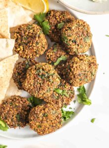 A plate of crispy falafel patties.