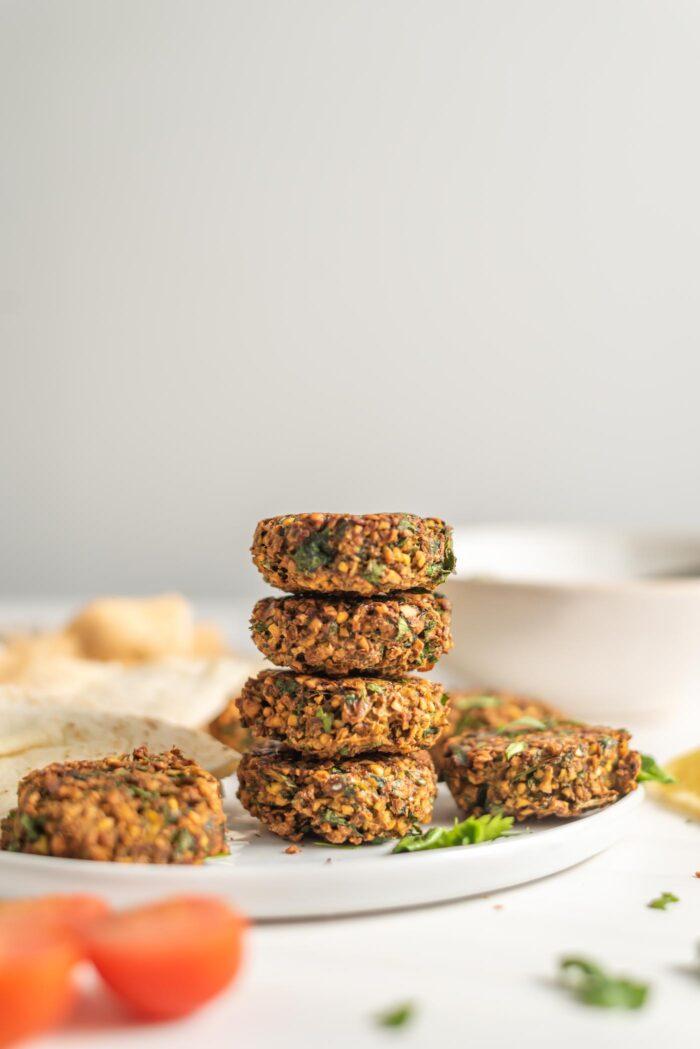 A stack of crispy falafel on a plate.